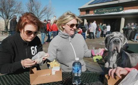 Kate Lin of Weymouth, her aunt Kerrie Tobin of Dorchester, and Baxter, a great Dane, enjoyed the food and the weather.